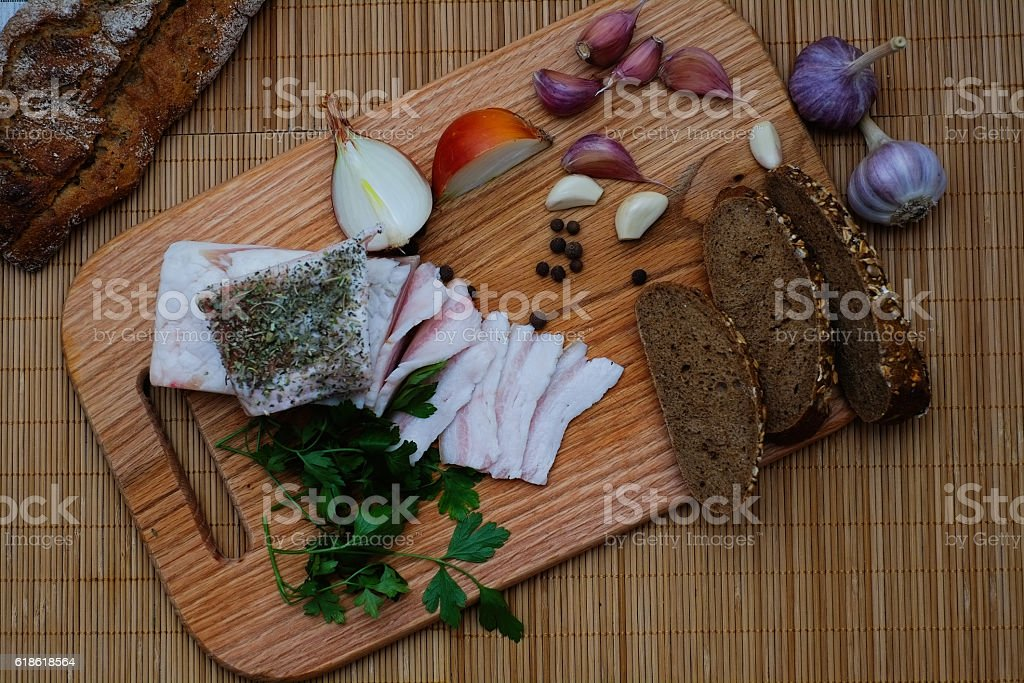 bacon with bread garlic and onions stock photo
