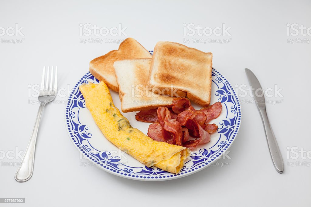 bacon with eggs whit knife and fork stock photo
