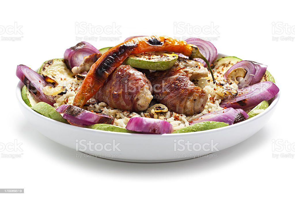 bacon wrapped chicken with rice and vegetables stock photo