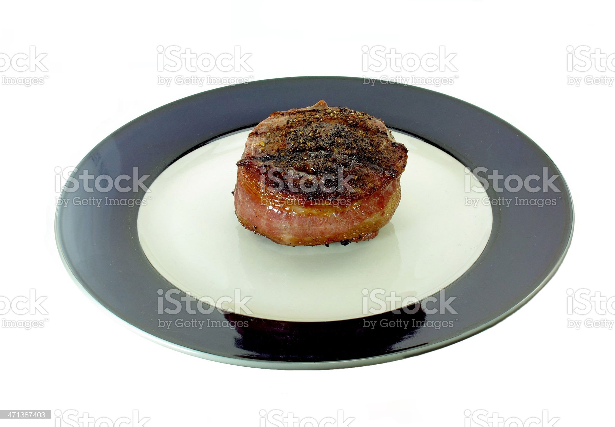 Bacon Wrapped Filet on Plate royalty-free stock photo