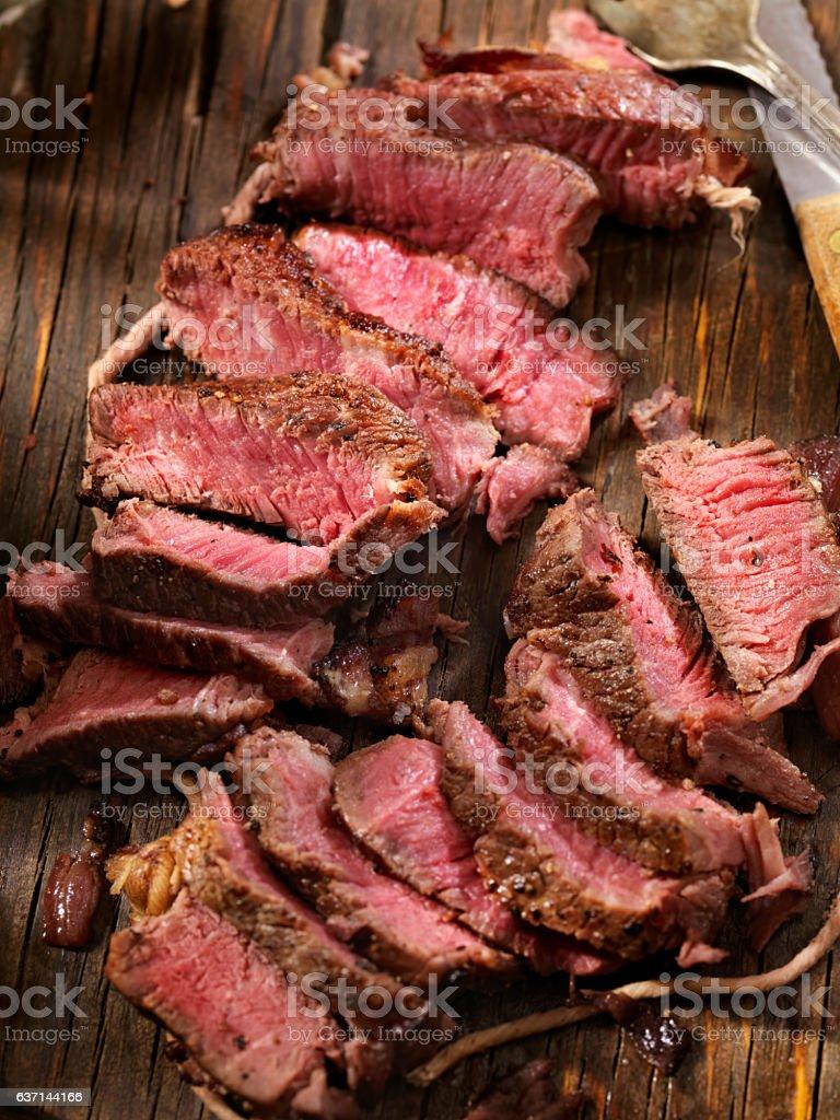 Bacon Wrapped Medium Rare Steak Fillets Sautéed in Garlic Butter stock photo