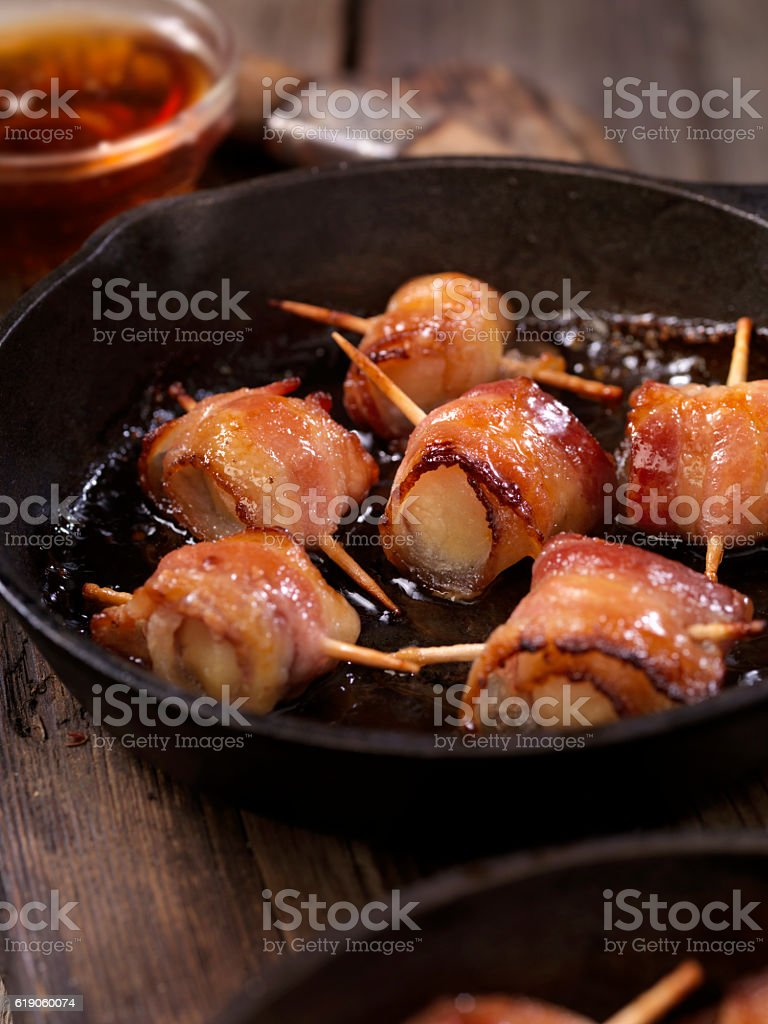 Bacon Wrapped Scallops in a Maple Glaze stock photo