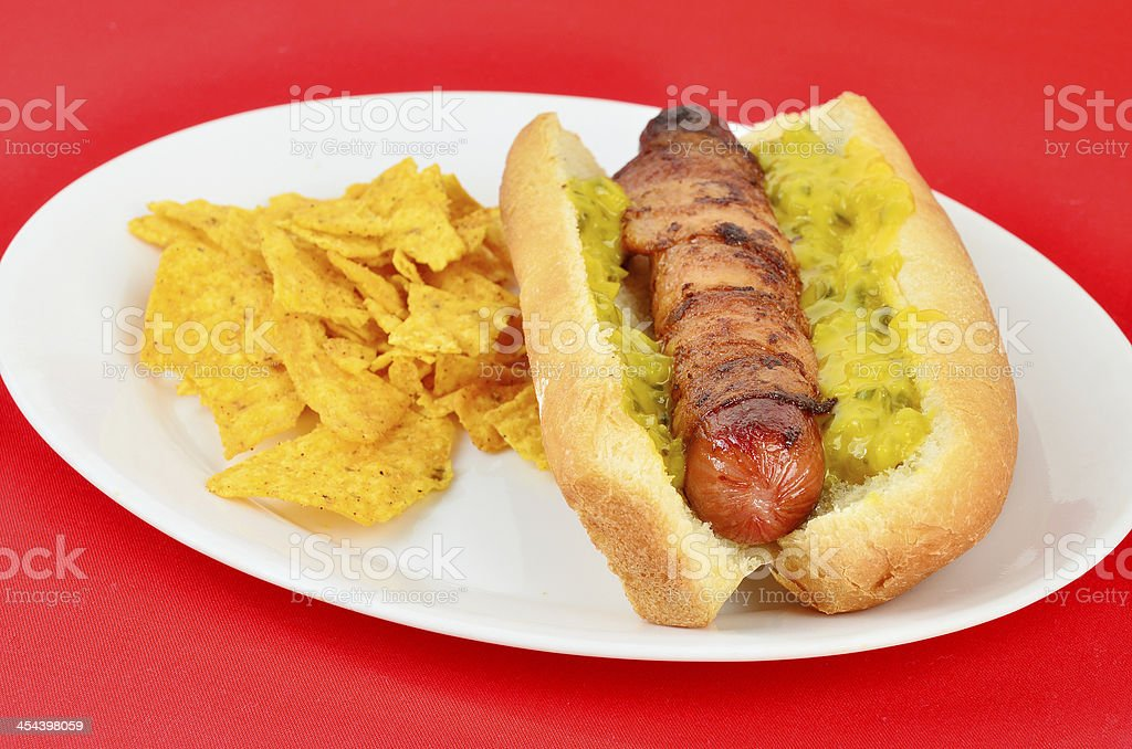 Bacon-wrapped Hot Dog royalty-free stock photo