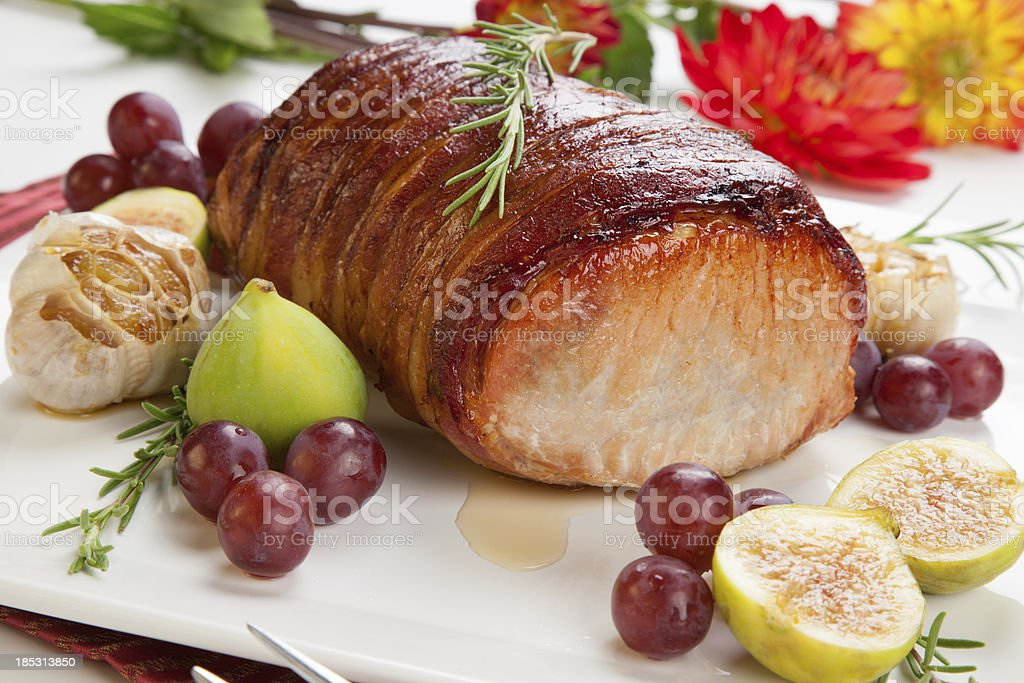 Bacon-wrapped Pork Loin with Fruits stock photo