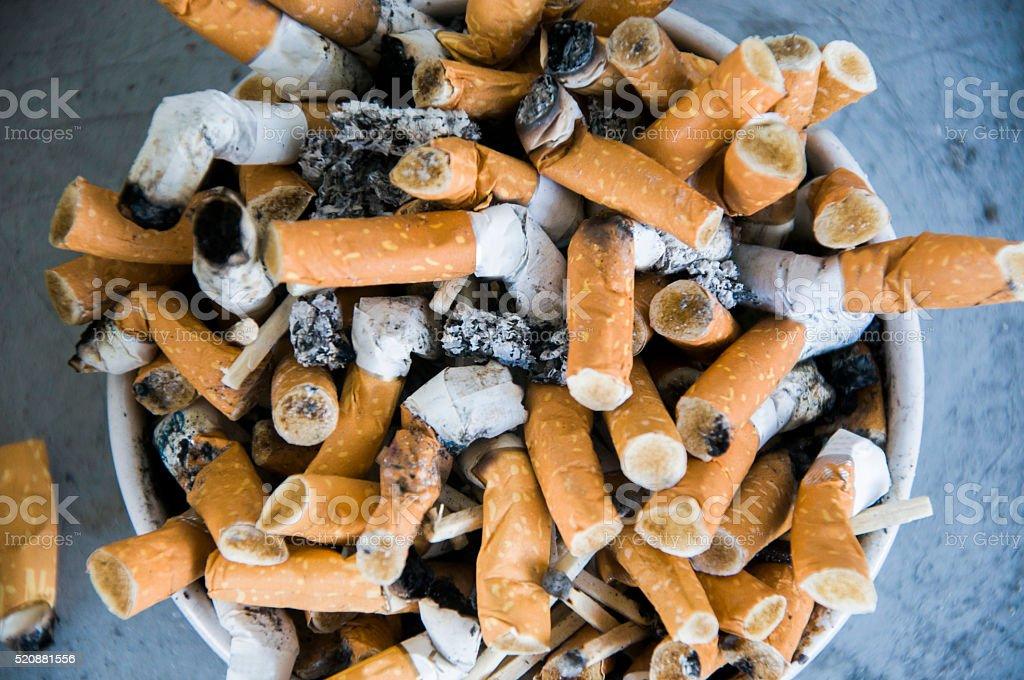 Bad addiction. Ashtray and cigarettes close-up stock photo