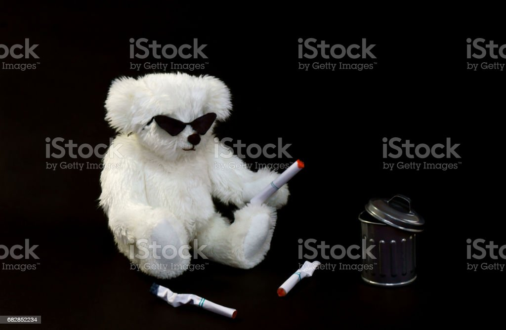 A bad bear to litter a cigarette stock photo
