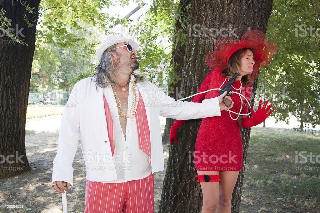 Bad Boss Threating a Kidnapped Girl royalty-free stock photo