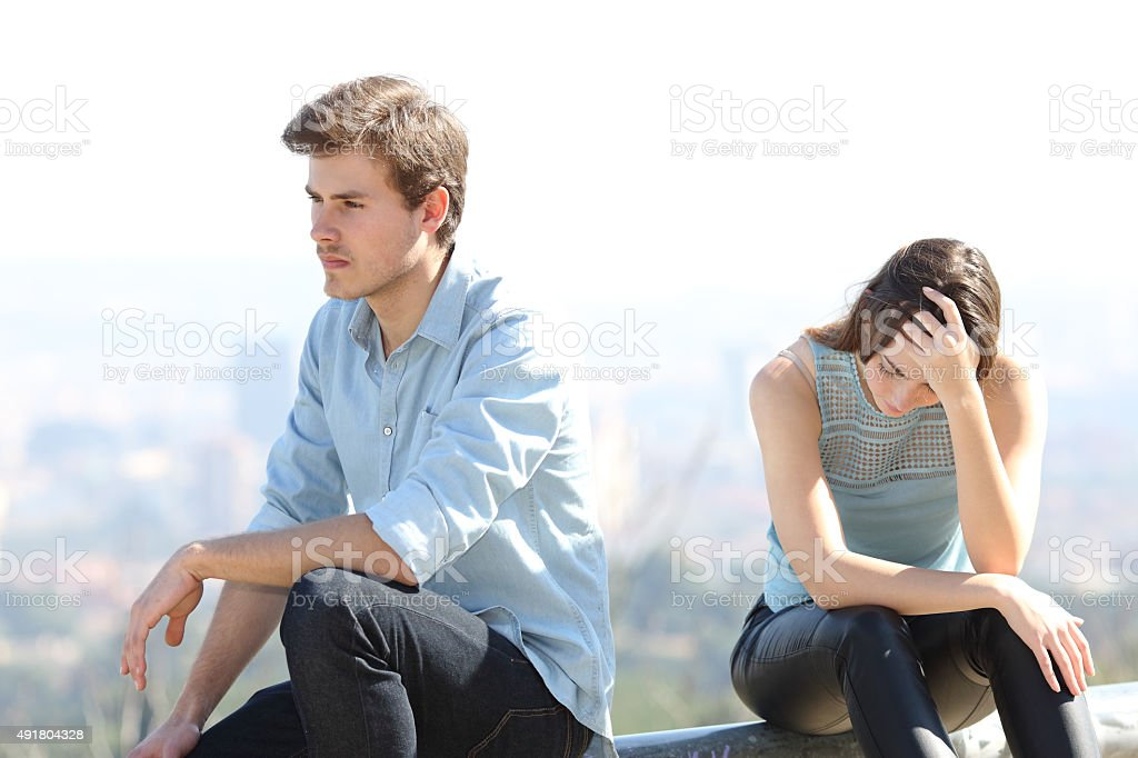 Bad boy arguing with his couple breakup concept stock photo