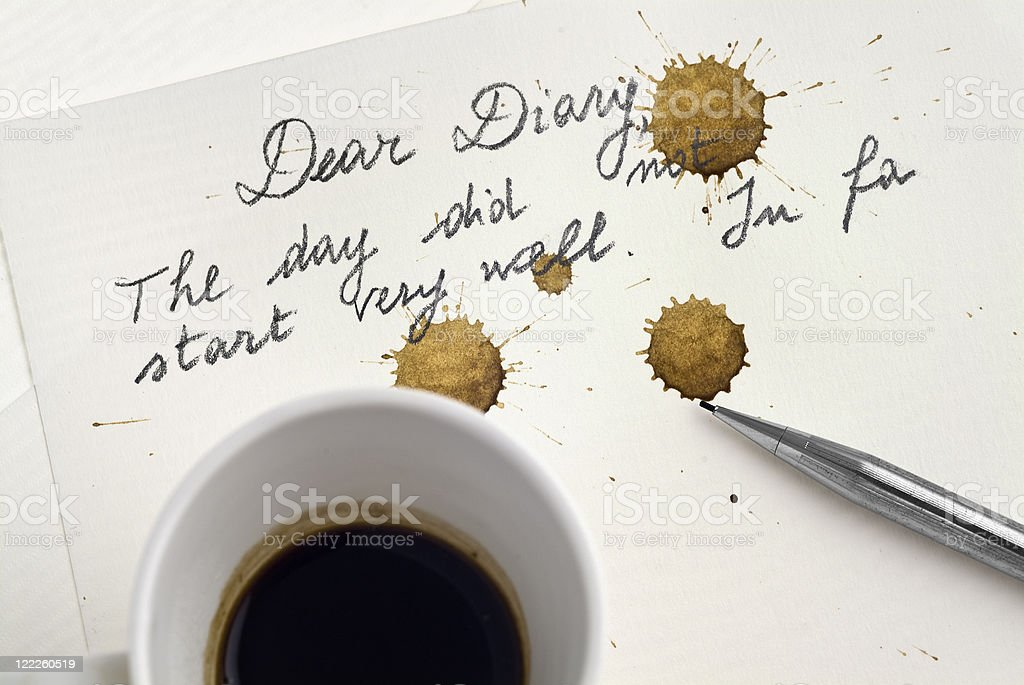 Bad day: The coffee stains the diary page - POV stock photo