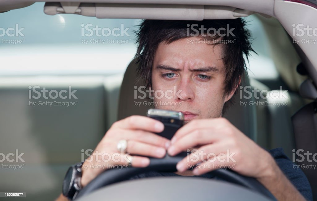 Bad Driver: Teen Texting while Driving royalty-free stock photo