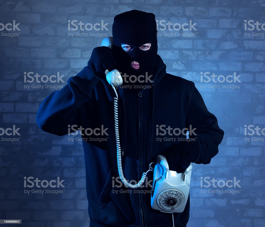 Bad guy on the phone royalty-free stock photo