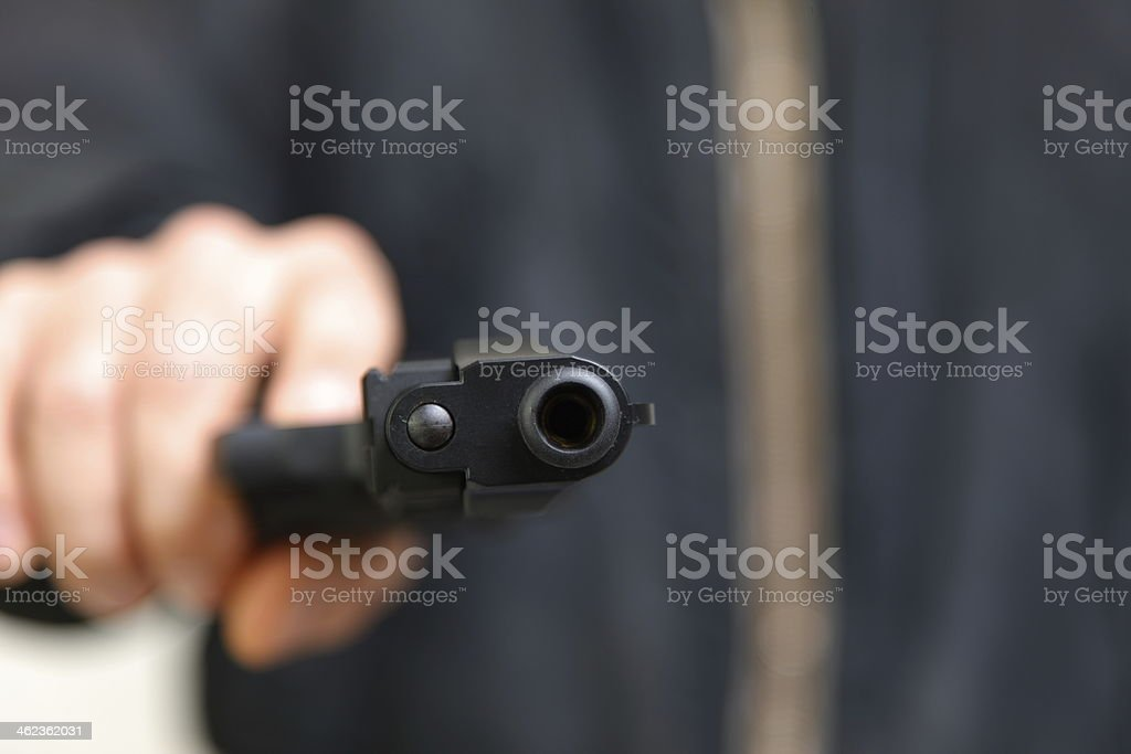 bad guy with a hand gun stock photo