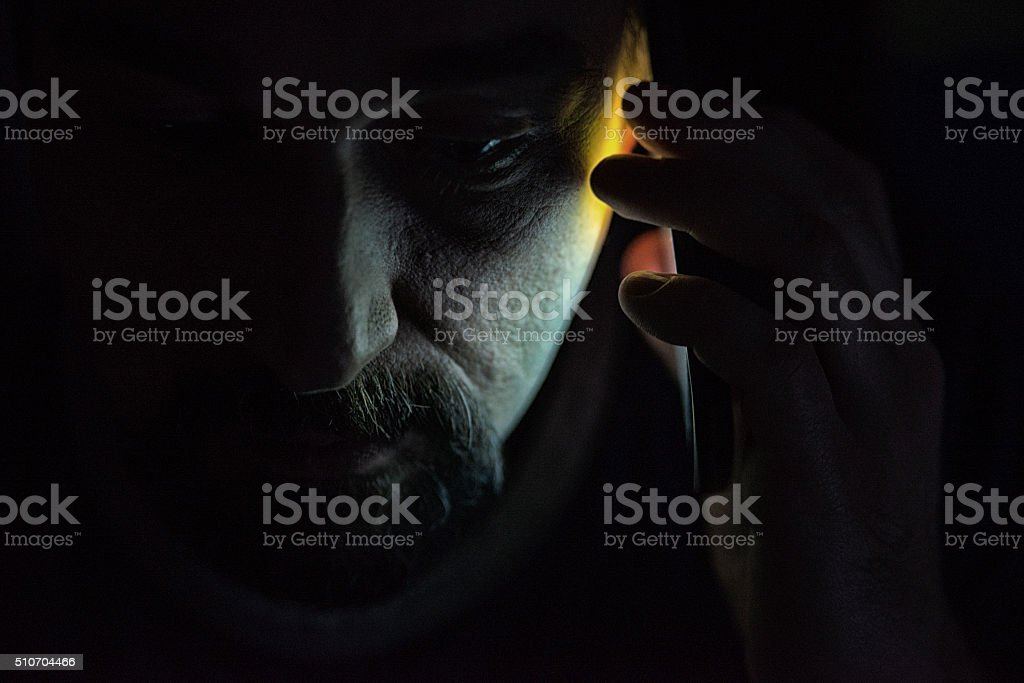 Bad news-Man talking on phone in pain stock photo