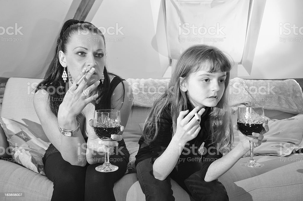 Bad role model mother with daughter royalty-free stock photo