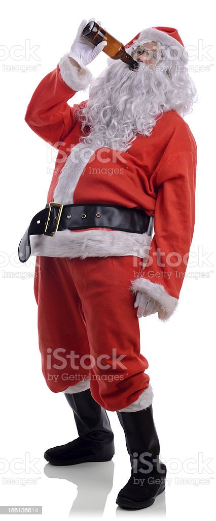 Bad Santa drinking a beer isolated on white stock photo