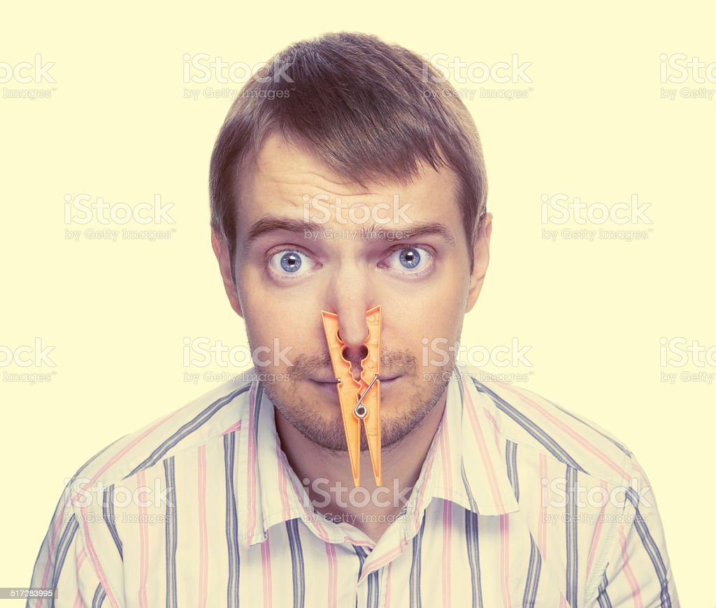 Bad smell concept photography. Toned image. stock photo