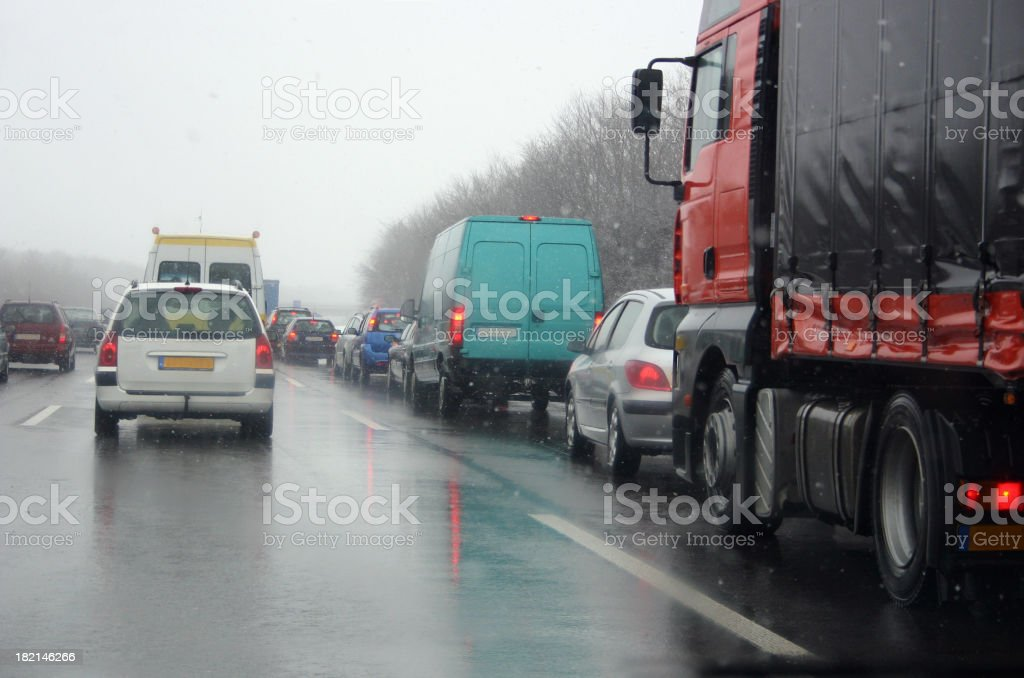 Bad traffic in sad weather royalty-free stock photo