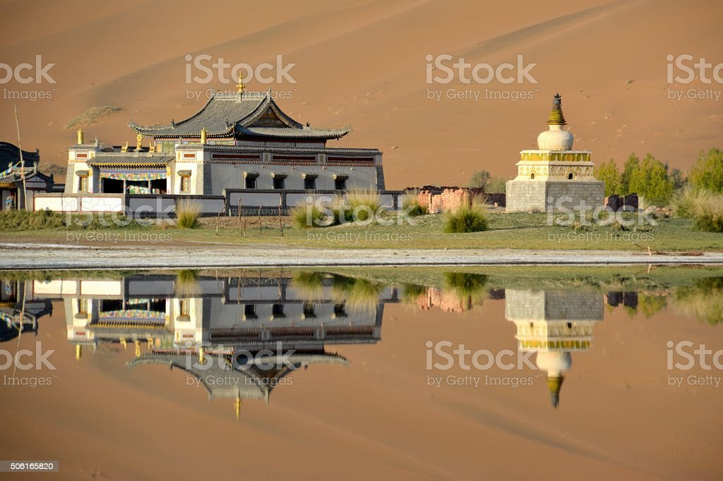 Badain Jaran Temple, reflecting on its lake, Inner Mongolia stock photo