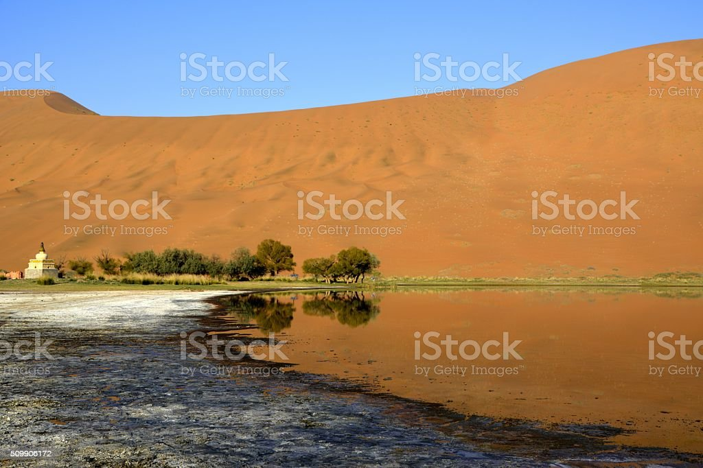 Badain Jaran Temple stupa, on its lake, Inner Mongolia stock photo