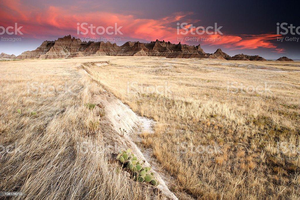 Badlands and Prairie Field at Sunset stock photo