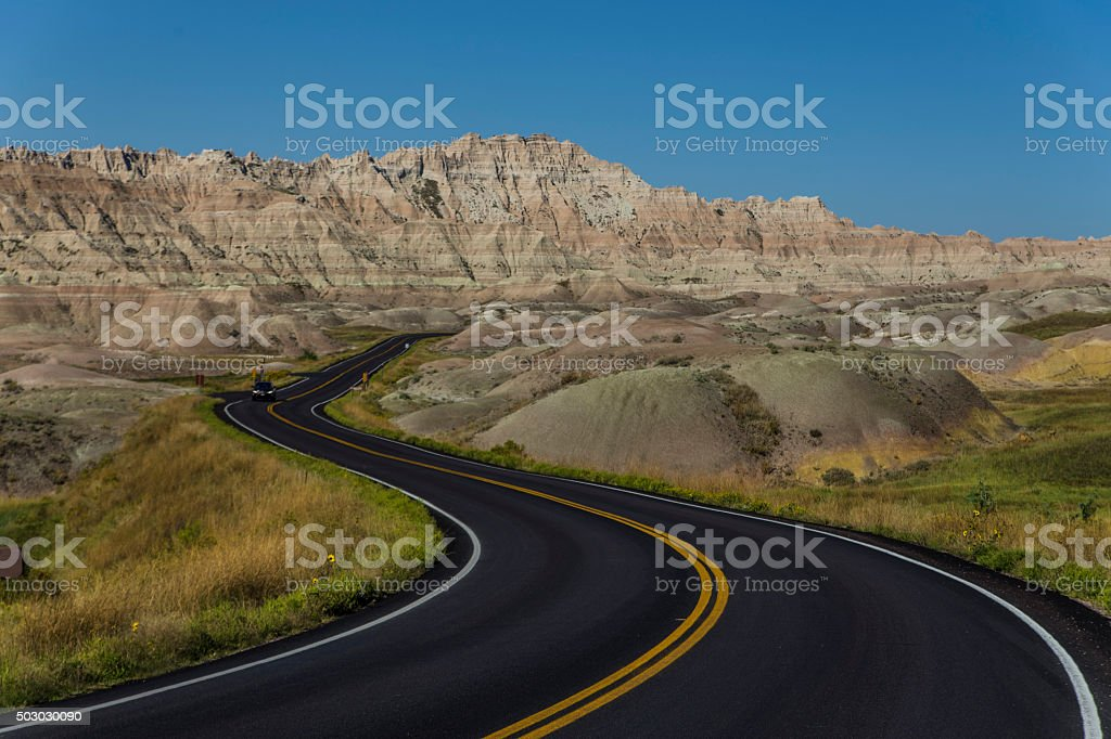 Badlands curved road stock photo