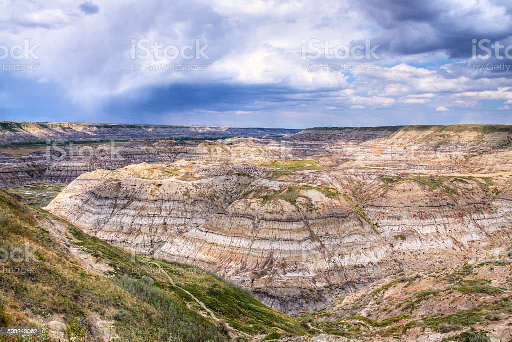 Badlands of Horse Thief Canyon with Rain Clouds HDR stock photo