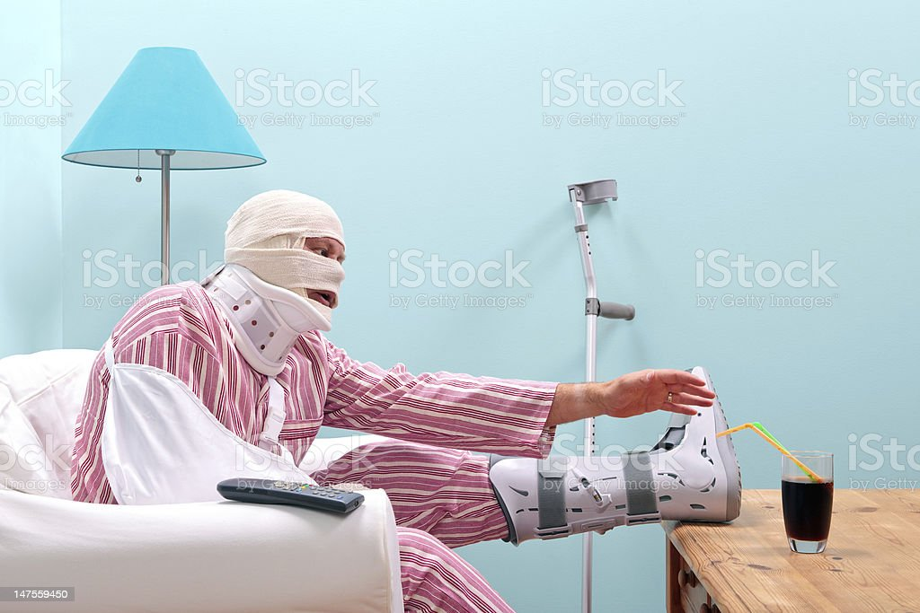 Badly injured man recovering at home stock photo