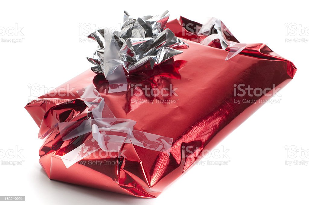 Badly wrapped, messy Christmas present stock photo