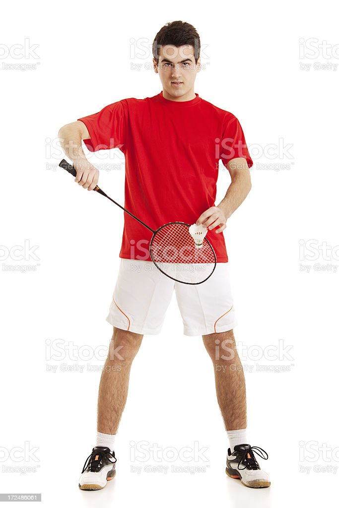 Badminton player preparing to hit the ball with racket royalty-free stock photo