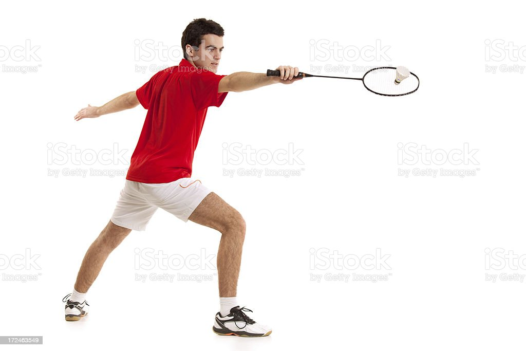 Badminton player with a racket in his hand hit shuttlecock royalty-free stock photo