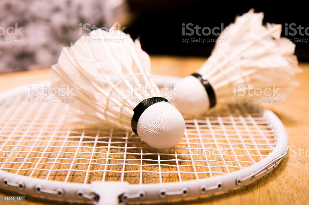 Badminton racket and shuttlecock on the table stock photo