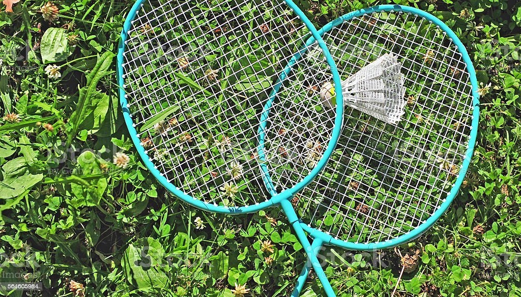 Badminton rackets in the grass stock photo