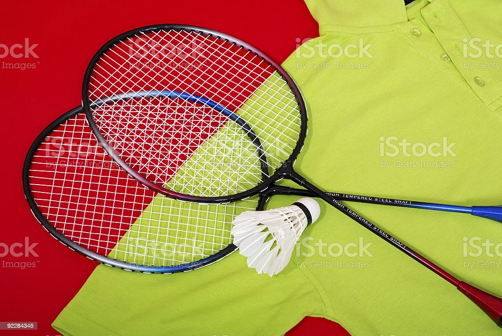 Badminton rackets with shuttlecock on shirt royalty-free stock photo