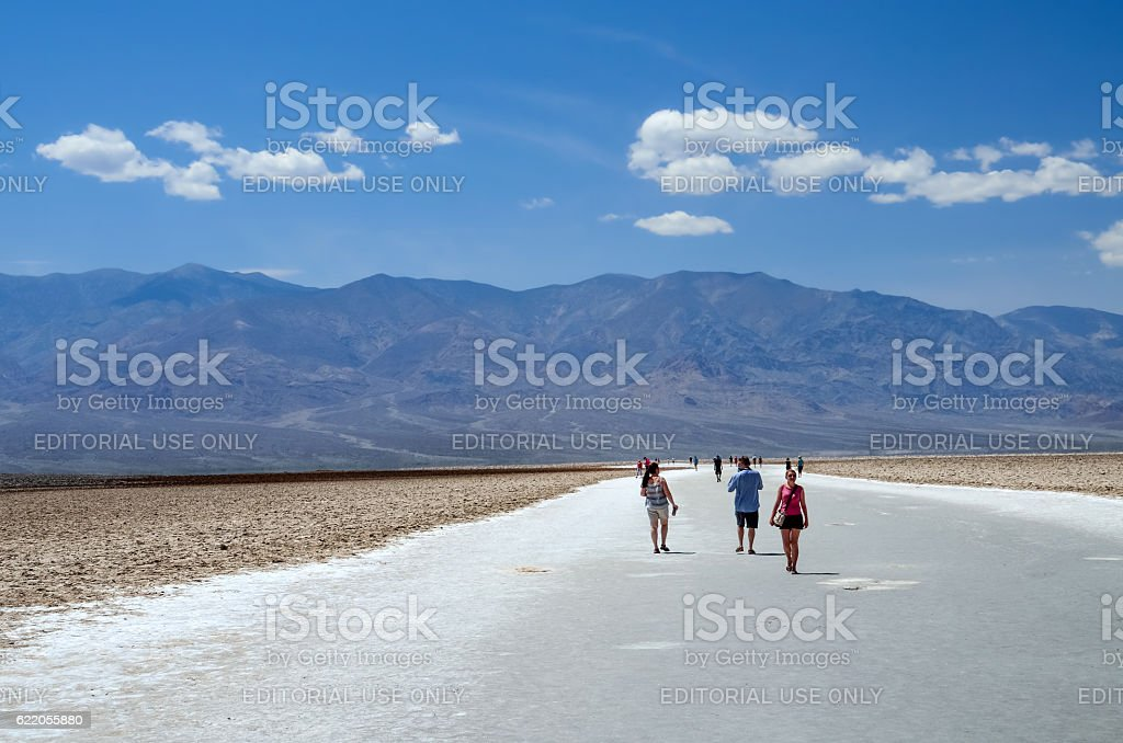 Badwater basin with people walking on salt flats stock photo
