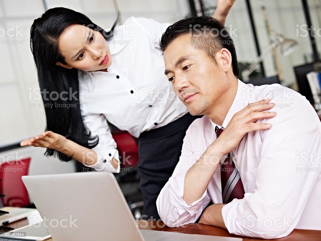 baffled asian businesswoman stock photo