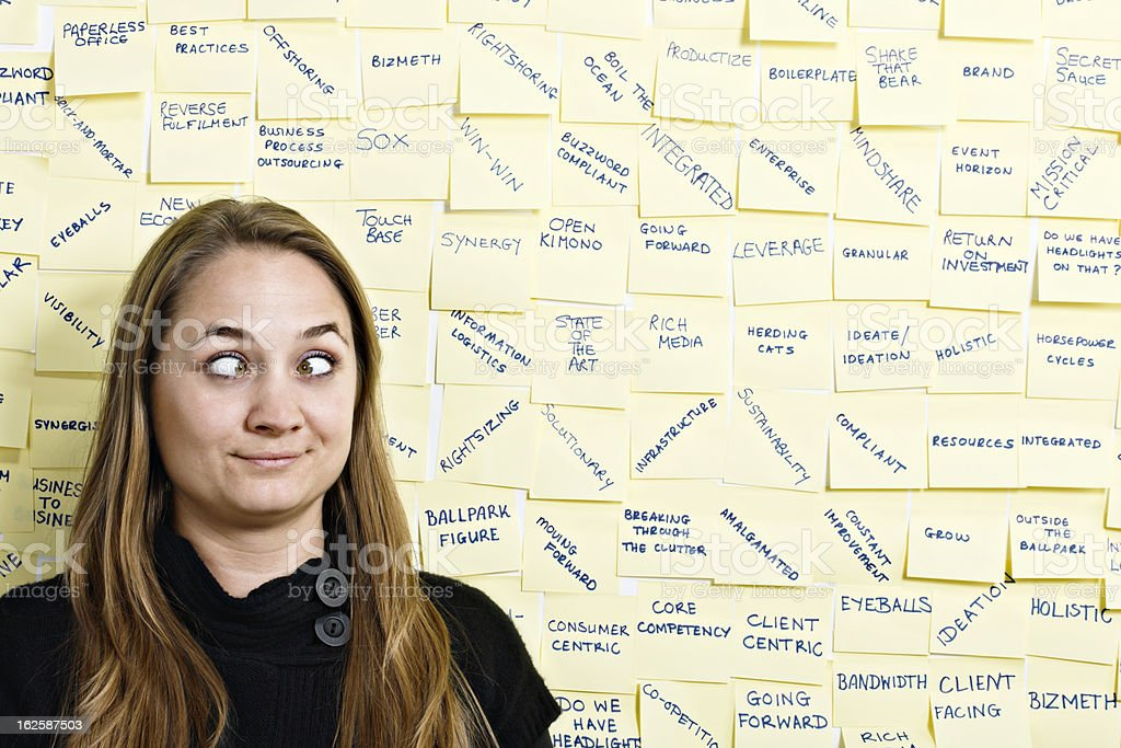 Baffled by business buzzwords, woman squints in confusion royalty-free stock photo