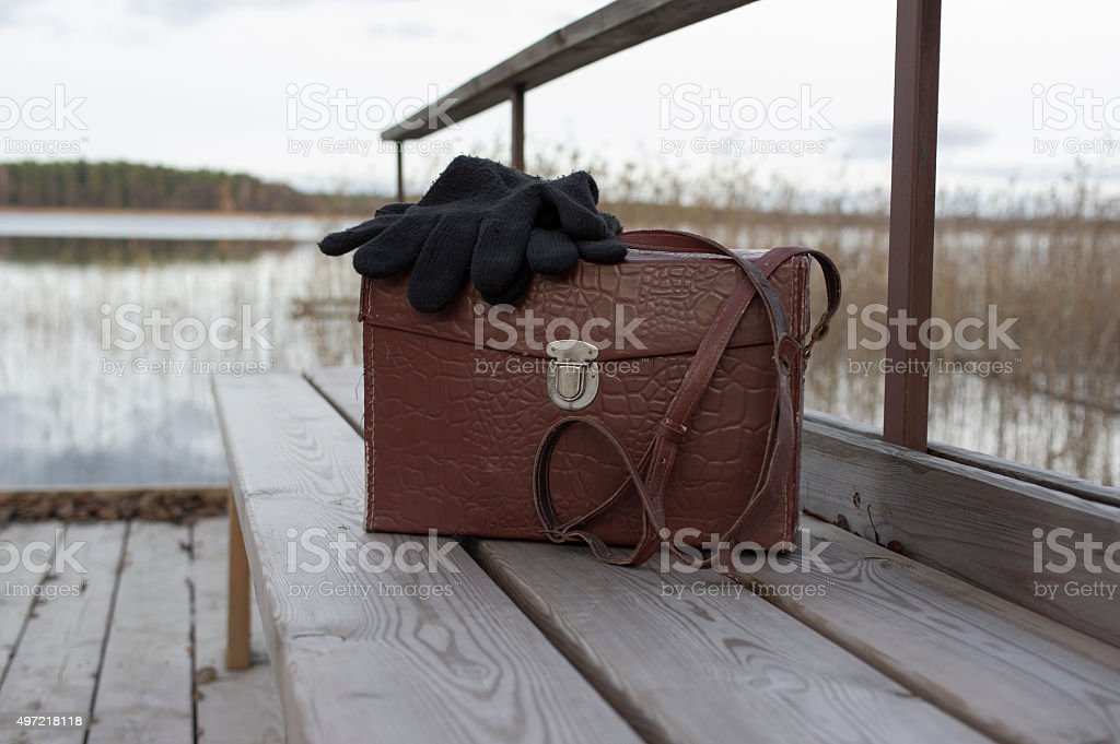 Bag And Gloves On Bench stock photo