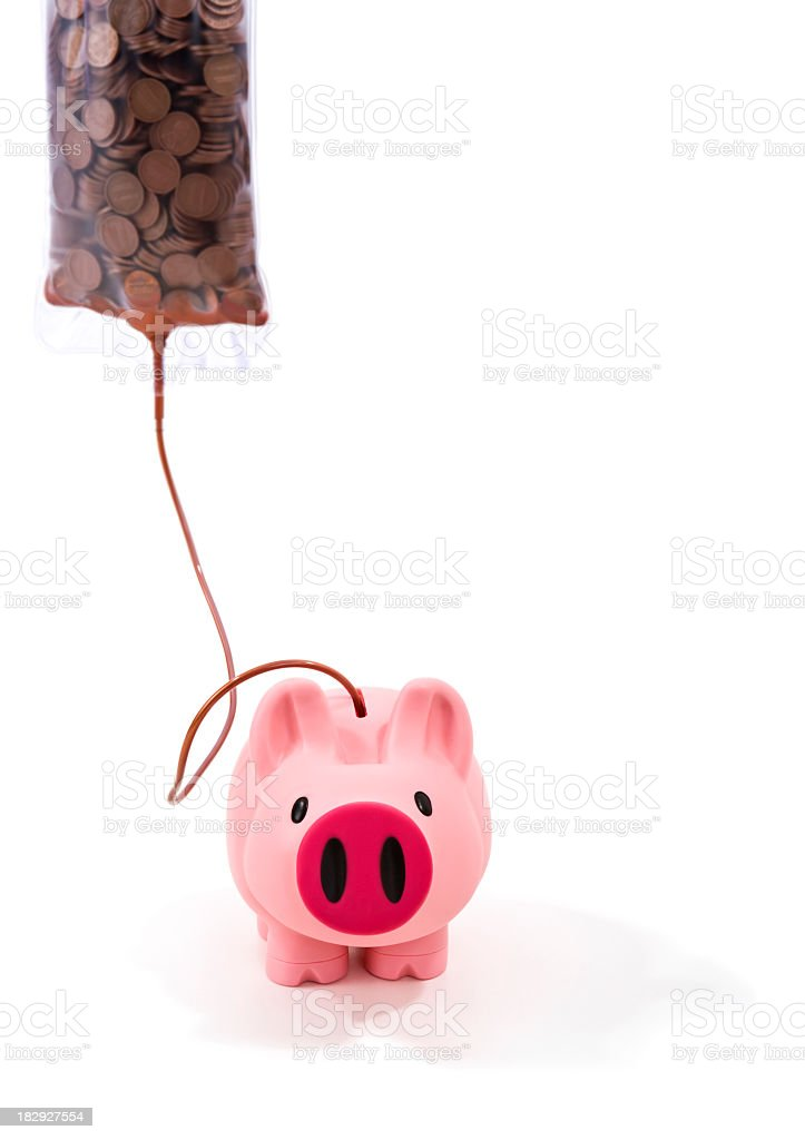IV bag feeding pennies into a piggy bank. royalty-free stock photo