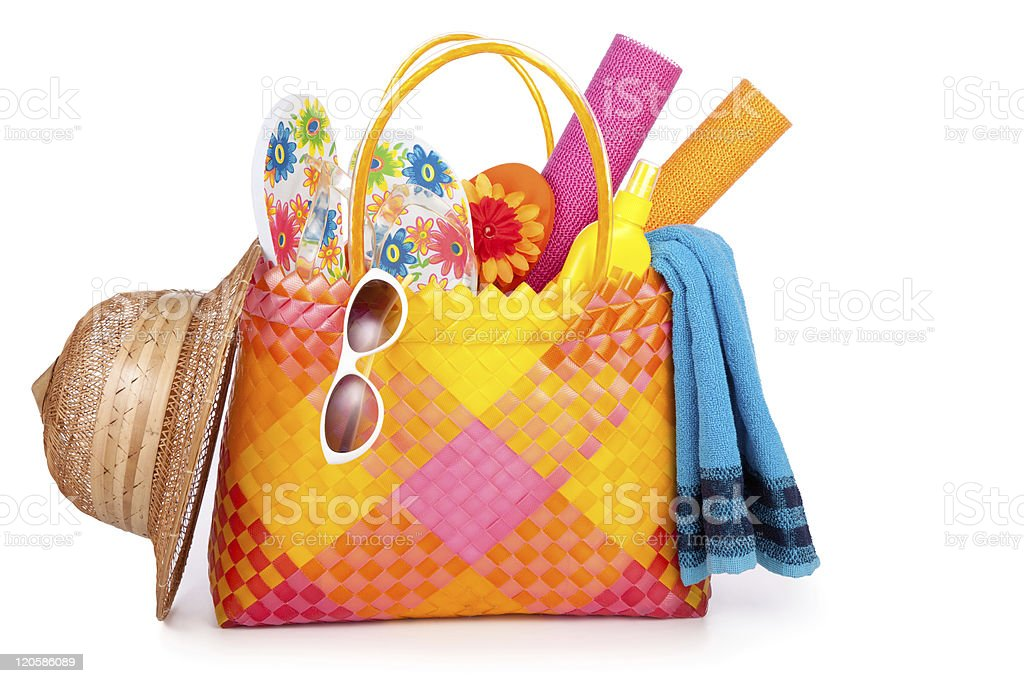 Bag filled with beach items and accessories royalty-free stock photo