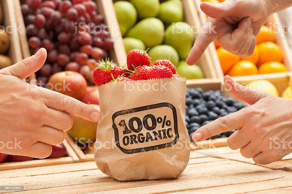 Bag full of 100% organic fruit royalty-free stock photo
