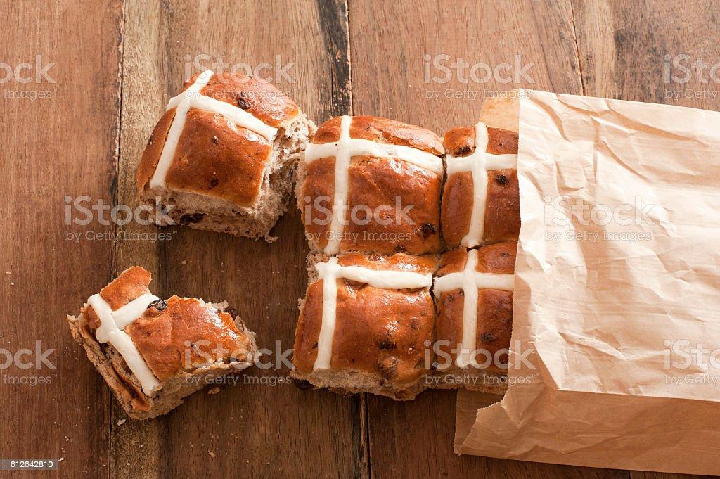 Bag full of fresh hot cross buns stock photo