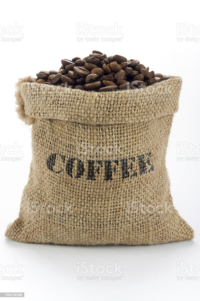 A bag of coffee beans that are labeled royalty-free stock photo