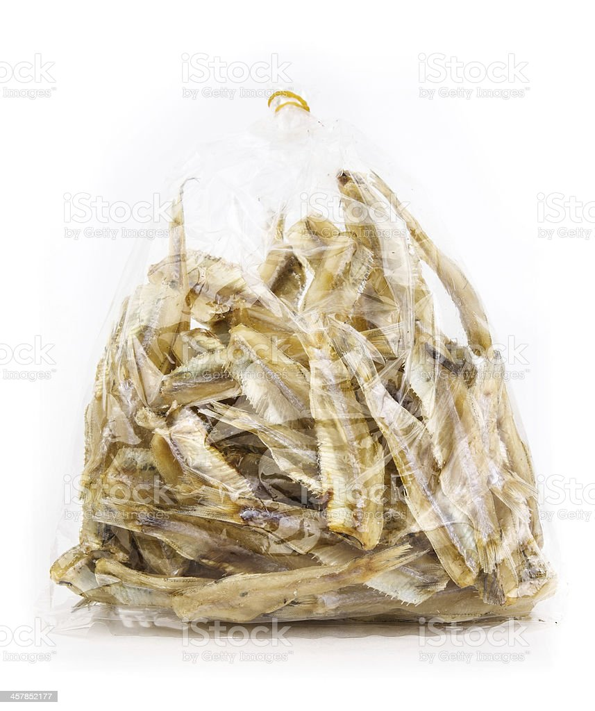 Bag of dry fish on white background stock photo