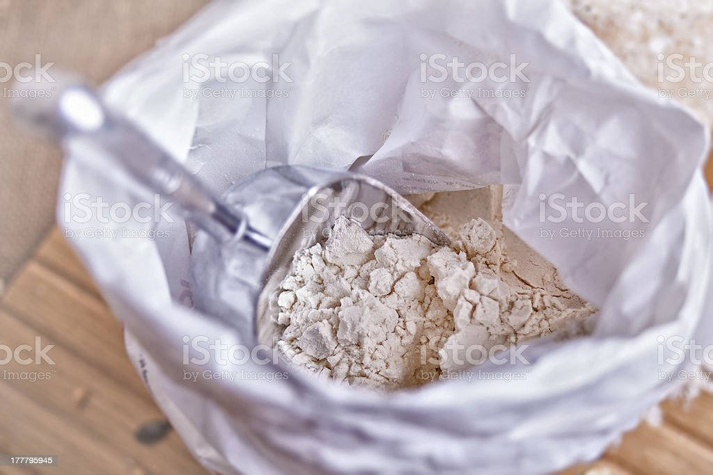 bag of flour with scoop stock photo
