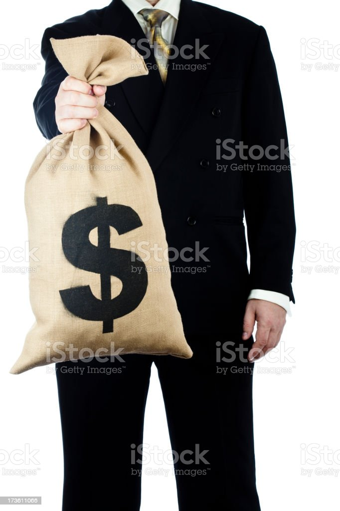 Bag of money held by businessman royalty-free stock photo