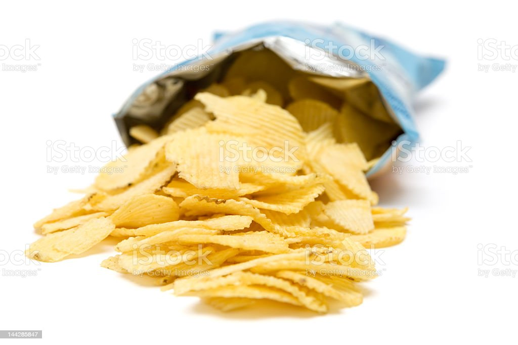 Bag of open potato chips pouring towards the viewers stock photo