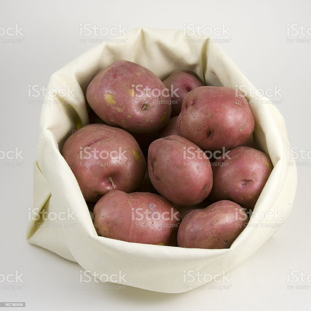 Bag of Red Potatoes royalty-free stock photo