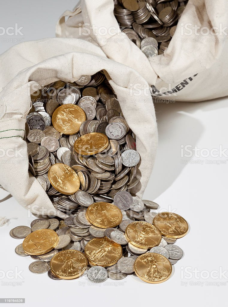 Bag of silver and gold coins stock photo
