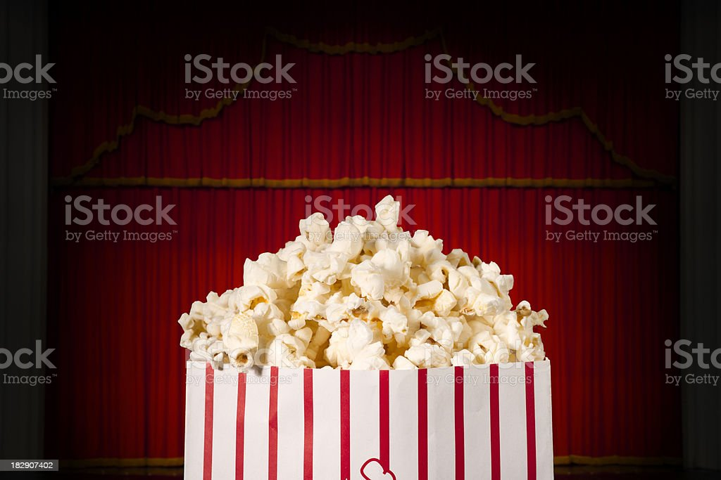 Bag of theater popcorn before a show royalty-free stock photo