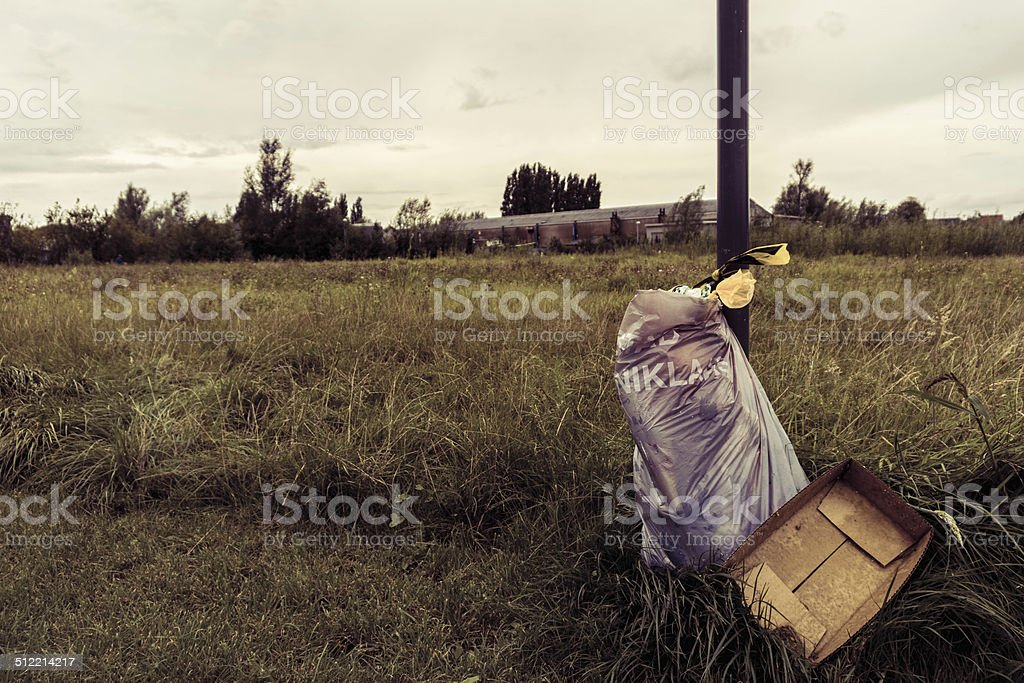 Bag of trash in nature stock photo